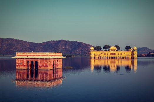 Vintage retro hipster style travel image of Rajasthan landmark - Jal Mahal (Water Palace) on Man Sagar Lake on sunset. Jaipur, Rajasthan, India