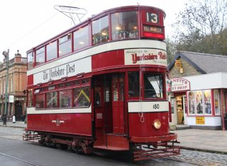 Tram at Crich Tramway village 180 sweetshop and Red Lion