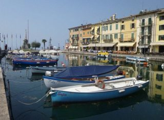 Lasize Lake Garda boats at the harbour, Italy - European Travel
