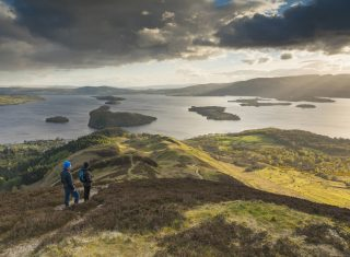 Loch Lomond & Trossachs National Park, Scotland - Walkers taking in the view of Loch Lomond from Conic Hill part of the West Highland Way © VisitScotland, Kenny Lam EXPIRES 3.12.2021