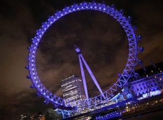 London Eye by night London showboat River Thames Christmas