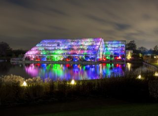 RHS Garden Wisley, nr Woking, Surrey - Christmas Glow 2017-Glasshouse with liights © RHS, Paul Debois