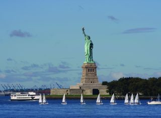 The statue of Liberty across the water