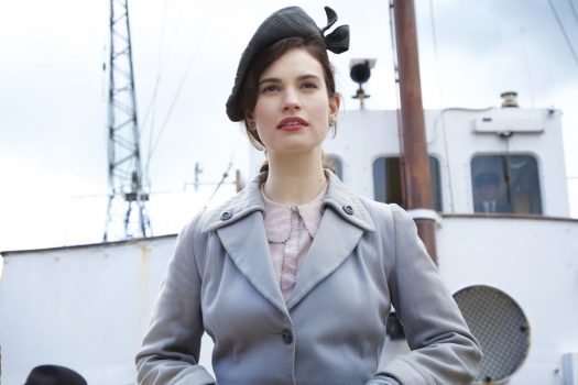he Guernsey Literary and Potato Peel Pie Society film still - Lily James playing Juliet Ashton (01) © STUDIOCANAL S.A.S