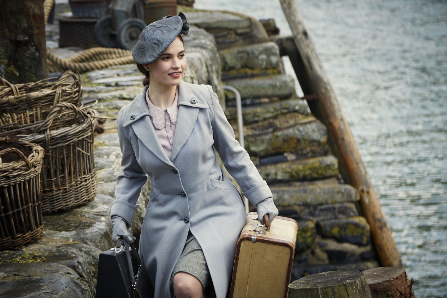 The Guernsey Literary and Potato Peel Pie Society film still - Lily James playing Juliet Ashton (02) © STUDIOCANAL S.A.S