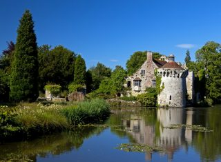 View across the lake towards Scotney Castle, Kent ©National trust images, Robert Morris