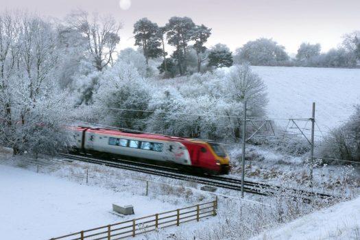 Virgin train travelling through snow