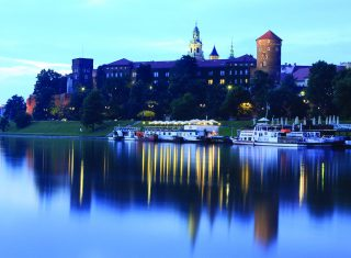 A lakeside view of the Gothic Wawel Castle in krakow, Poland